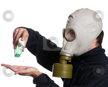 Clean Hands stock photo, Closeup view of a man wearing a gas mask using some hand sanitizer to kill any germs, isolated against a white background by Richard Nelson