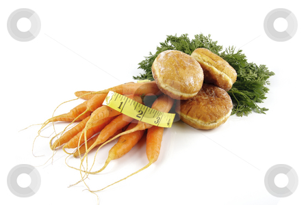 Carrots and Doughnut with Tape Measure stock photo, Contradiction between healthy food and junk food using bunch of carrots and doughnut with a tape measure on a reflective white background by Keith Wilson