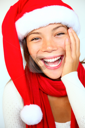 Christmas woman stock photo, Christmas woman in a Santa hat very surprised and excited. Isolated on white background. by Maridav