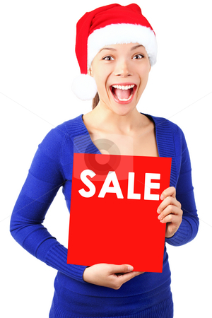 Woman with christmas sale sign  stock photo, Excited christmas woman with santa hat holding red sale sign. Isolated on white background. by Maridav
