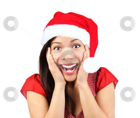 Christmas woman surprised stock photo, Christmas girl very excited and surprised holding her head. Beautiful mixed asian / caucasian model. Isolated on seamless white background. by Maridav