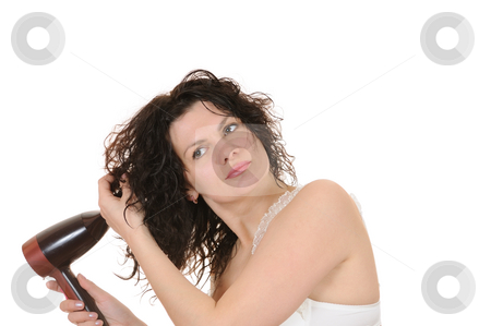 Care of hair stock photo, The woman dries the hair dryer hair by Salauyou Yury