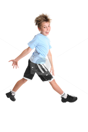 Feeling Happy stock photo, A boy stepping out feeling happy by Leah-Anne Thompson