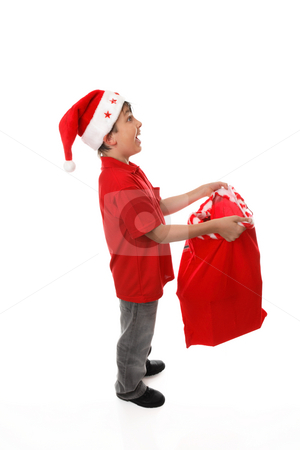 Filling up a santa sack-  add your products concept stock photo, Full length wide-eyed, excited child holds open a red sack catching things.   Blank.  You add your own toys, gifts, books, electronics, stationery,to suit your business or concept.. by Leah-Anne Thompson