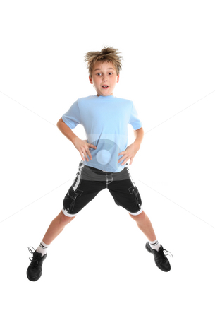 Fitness jumps stock photo, A boy doing fitness exercises on a white background. by Leah-Anne Thompson