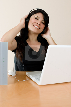 Internet Music stock photo, A woman listens to streaming music or video or music downloaded from the internet. by Leah-Anne Thompson