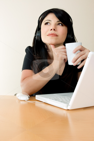 Coffee Break stock photo, Woman relaxes with a coffee by Leah-Anne Thompson