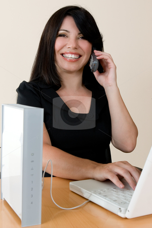 Wireless Freedom stock photo, A woman enjoys the freedom of wireless networking and phone calls by Leah-Anne Thompson