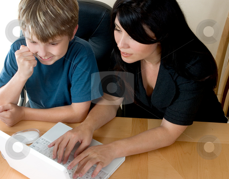 Woman and child on computer  stock photo, Woman and child using a laptop computer to access information, shopping, e-mail, , etc. by Leah-Anne Thompson