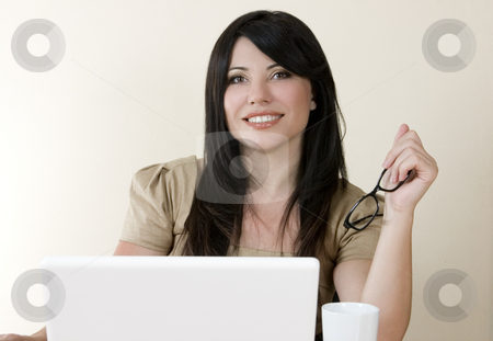 Business woman stock photo, Smiling businesswoman at computer. by Leah-Anne Thompson
