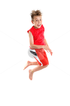 Jump for Joy stock photo, An enthusiastic, excited,  happy  boy jumps off the ground. by Leah-Anne Thompson