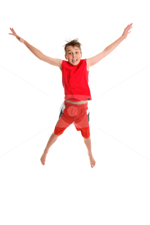 Starjump stock photo, Starjump.  A young boy jumps into the air by Leah-Anne Thompson