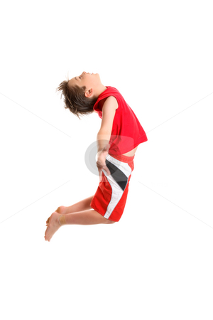 Boy jumpging arms outstretched stock photo, A boy jumps and spreads with arms.  Motion in fingers and feet and parts of the boys hair. by Leah-Anne Thompson