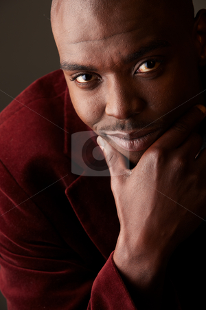 Young African businessman stock photo, Young black African businessman in semi-formal clothes on a grey background with various facial expressions. Not Isolated, Part of a series. by Sean Nel