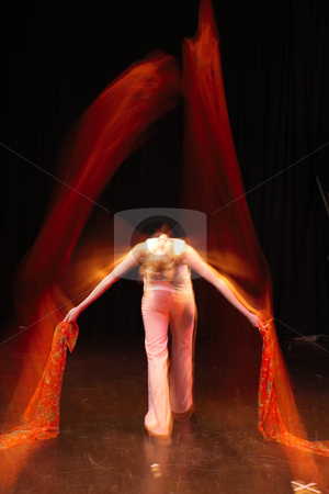 Dancer on Stage stock photo, Single Caucasian female freestyle hip-hop dancer in a dancing training session. Lit with spotlights. Movement on edges of dancer by Sean Nel