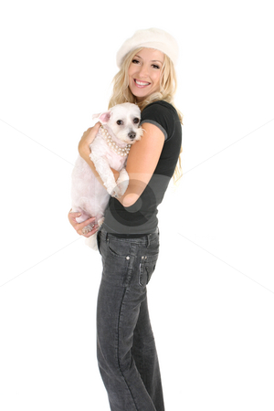 Woman holding a small dog stock photo, Smiling woman carrying a small white dog in her arms. by Leah-Anne Thompson