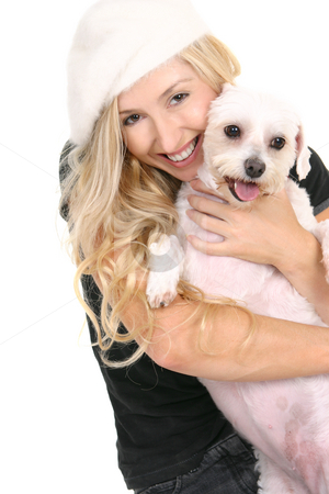 Happy girl cuddling dog stock photo, A smiling woman cuddling a cute lovable white dog by Leah-Anne Thompson