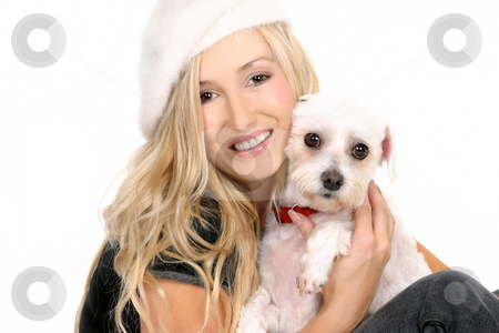 Sitting girl cuddling a dog stock photo, A sitting female hugging a small white dog by Leah-Anne Thompson