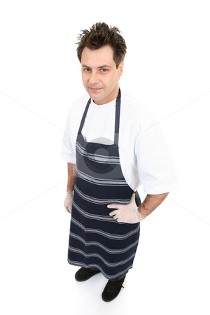 Butcher stock photo, Butcher in uniform standing with hand resting casually  on hip. by Leah-Anne Thompson