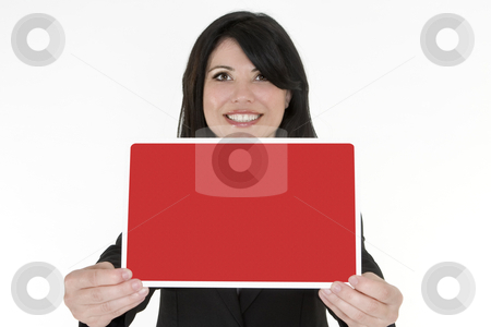Female holding a small blank sign stock photo, Female holding in front of her a blank red and white sign by Leah-Anne Thompson