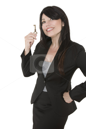 Key to ... stock photo, Smiling woman holding a key in her hand by Leah-Anne Thompson