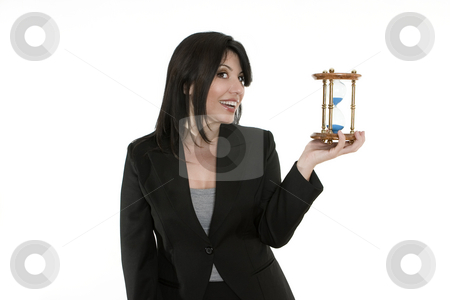 Time on your hands stock photo, A businesswoman holding a traditional sand timer in her hand. You could change the sandtimer for another product. by Leah-Anne Thompson