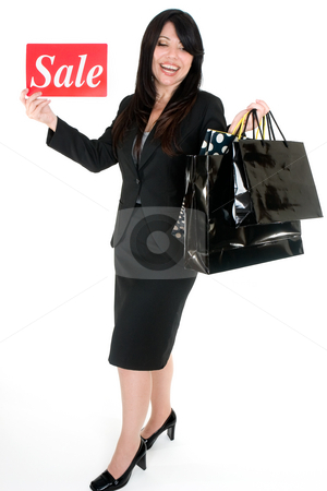 Its Sale Time - Woman with shopping bags stock photo, An excited woman holding some boutique shopping bags. by Leah-Anne Thompson