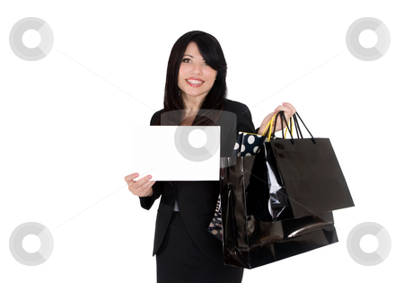 Boutique shopper holding a sign stock photo, A female holding some boutique shopping bags and a blank sign or message by Leah-Anne Thompson