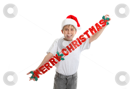 Merry Christmas Decoration stock photo, A child holding a fabric Christmas decoration,  that says Merry Christmas by Leah-Anne Thompson