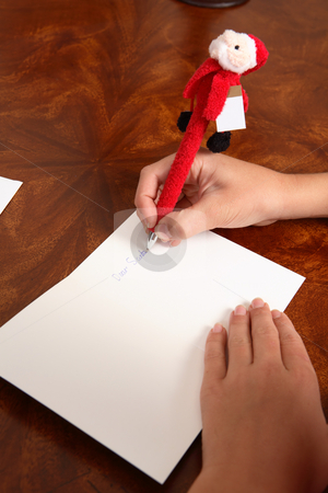 Dear Santa stock photo, Closeup of a child writing out a letter to santa by Leah-Anne Thompson