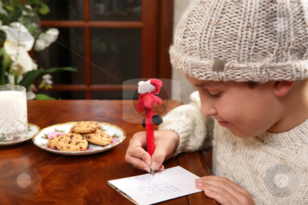 Christmas Wishlist stock photo, A child writes out his Christmas wishlist for Santa on Christmas Eve. by Leah-Anne Thompson