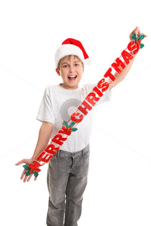 Child with Merry Christmas stock photo, A child holding a Christmas  decoration that says Merry Christmas by Leah-Anne Thompson