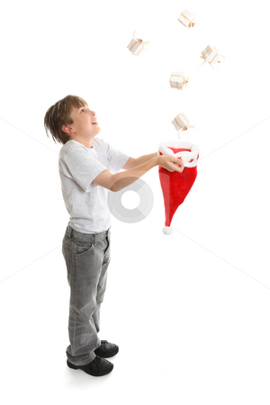 Boy catching presents stock photo, Gifts galore.   An excited  full length boy catches Christmas presents falling from above. by Leah-Anne Thompson