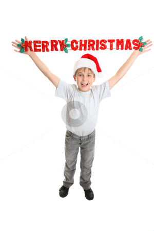 Christmas child with Joyful message stock photo, A joyful full length child holding up a Merry Christmas decoration above his head on a white background. by Leah-Anne Thompson