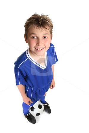 Boy wth soccer ball stock photo, Happy, standing boy wearing soccer uniform with soccer ball against white backdrop. Focus to face. by Leah-Anne Thompson