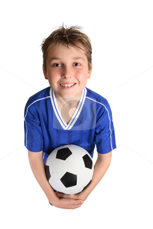 Boy holding soccer ball stock photo, A young boy in soccer uniform ready to play soccer. by Leah-Anne Thompson