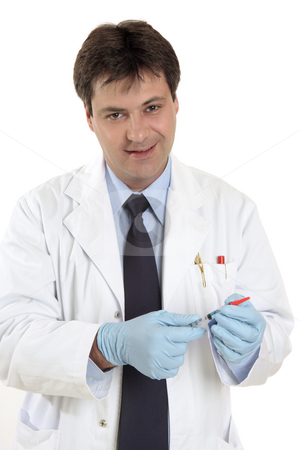 Doctor with syringe stock photo, Doctor or physician with a dose of medicine or vaccine in a srringe with protective cover. by Leah-Anne Thompson