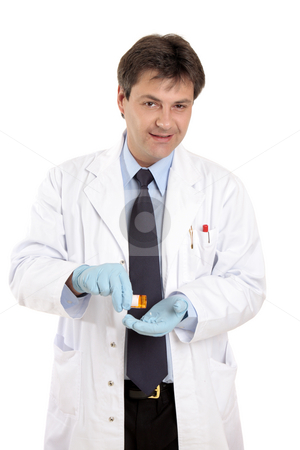 Doctor or vet with prescrption medicine stock photo, A doctor or veterinarian tipping pills into his hand from a prescription bottle. by Leah-Anne Thompson