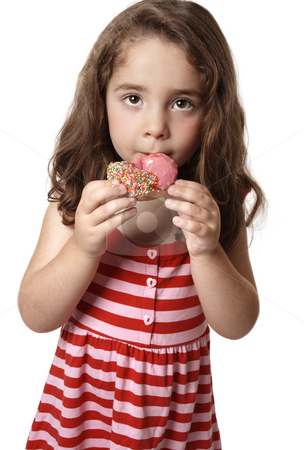 Unhealthy eating stock photo, A child eating an unhealthy doughnut snack. by Leah-Anne Thompson