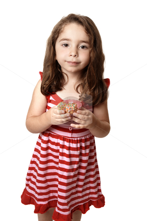 Beautiful  girl with sweet doughnut stock photo, Young child holding a pink iced doughnet.   She is wearing a pink and red striped dress with little pink  heart buttons. by Leah-Anne Thompson