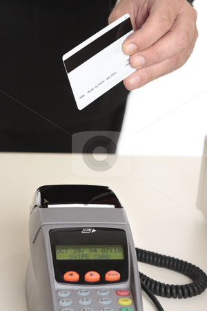Man paying with card stock photo, A man uses a gift card, debit or credit card for payment at checkout.  Focus to card.   Card details removed.  Eftpos terminal is not in focus. by Leah-Anne Thompson