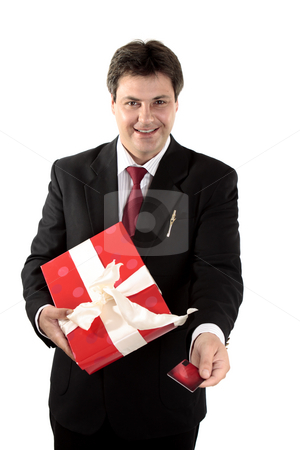 Man buying present stock photo, A man buys a  present with a gift card or credit debit card.  Focus to man, shallow dof. by Leah-Anne Thompson