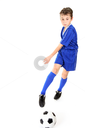 Child kicking ball stock photo, Child kicking or manoeuvring a soccer ball.  Motion to ball and kicking foot. by Leah-Anne Thompson