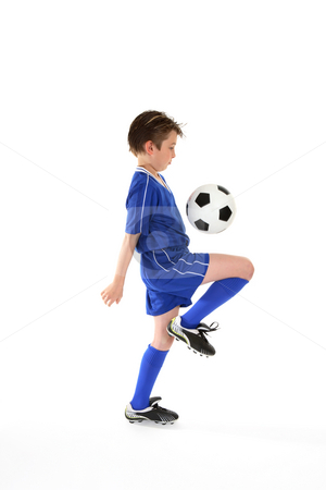 Soccer skills stock photo, Learning ball control by practicing various soccer skills. Slight motion to foot and ball by Leah-Anne Thompson