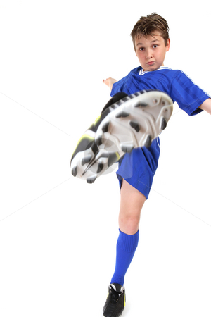Kickstart stock photo, A boy kicks high.  Kicking leg in motion. by Leah-Anne Thompson