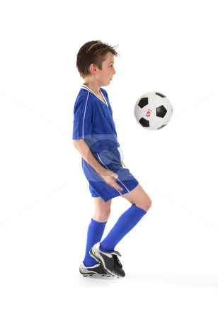 Soccer moves stock photo, A boy in training, practices some soccer moves.  Motion in bent leg and arm by Leah-Anne Thompson