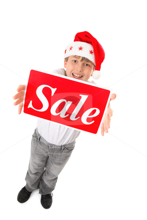 Christmas Sale Time stock photo, Standing child holding a sale sign up high suitable for pre or post Christmas sales by Leah-Anne Thompson