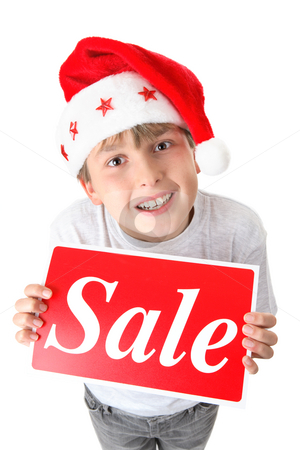 Bargain Christmas or holiday sales stock photo, Child holding a retail sale sign and looking up. by Leah-Anne Thompson