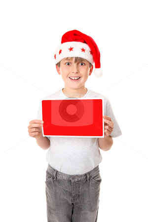 Boy with a Blank Message or Sign stock photo, A child dressed in grey jeans and grey marle t-shirt and wearing a red santa hat holding a small red and white blank sign ready for your message or graphics. by Leah-Anne Thompson