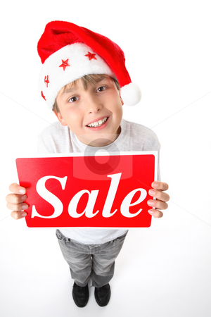 Standing boy holding sale sign stock photo, Full length standing boy holding a sale sign.  Suitable for pre and post Christmas sales.  Or add your own message. by Leah-Anne Thompson